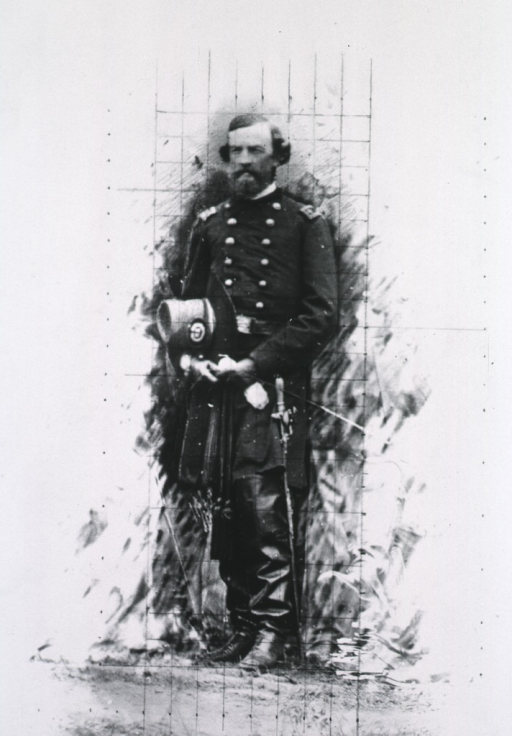 <p>Standing, full length, in uniform, boots, holding hat.</p>