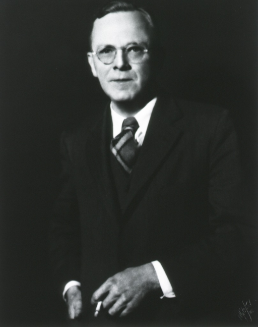 <p>Standing, front pose, wearing Scotch plaid tie.</p>