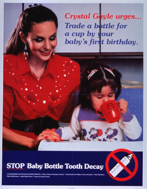 <p>Multicolor poster.  Title in upper right corner of poster.  Visual image is a reproducation of a color photo of singer Crystal Gayle with an infant girl.  The girl sits in a high chair and drinks from a two-handled cup.  Note below photo, along with an illustration of a baby bottle with a red &quot;do not&quot; sign.  Publisher information below note also lists six subordinate agencies of U.S. Dept. of Health and Human Services.</p>