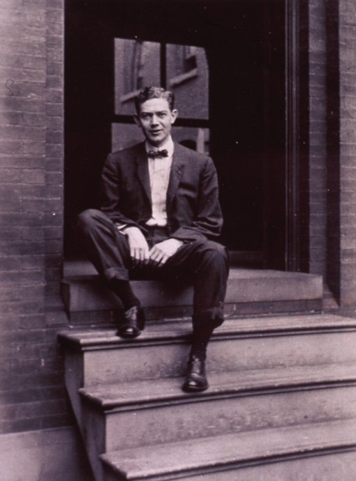 <p>Full length, seated on steps in doorway, full face.</p>