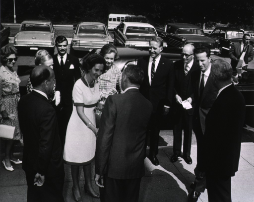 <p>Shows the arrival on the NIH campus of the King and Queen of Belgium, accompanied by Ambassador Emil Mosbacher, Jr. and his wife.  The are met by Dr. Robert Q. Marston (right side, back to camera) and others.</p>