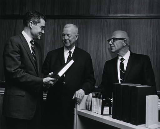 <p>Half-length, standing between Dr. Blake and Dr. Phillips.  On the occasion of Dr. Bayne-Jones' presentation of his interviews with Dr. Phillips to the National Library of Medicine.</p>