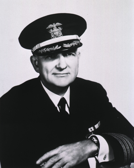 <p>Half length, full face, seated, hands folded; wearing naval uniform and cap.</p>