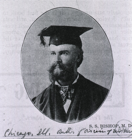 <p>Wearing cap and gown.</p>