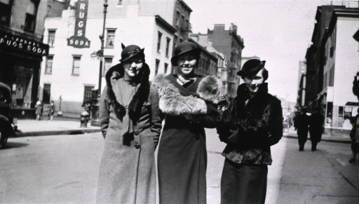 <p>Street scene showing three of the students.</p>