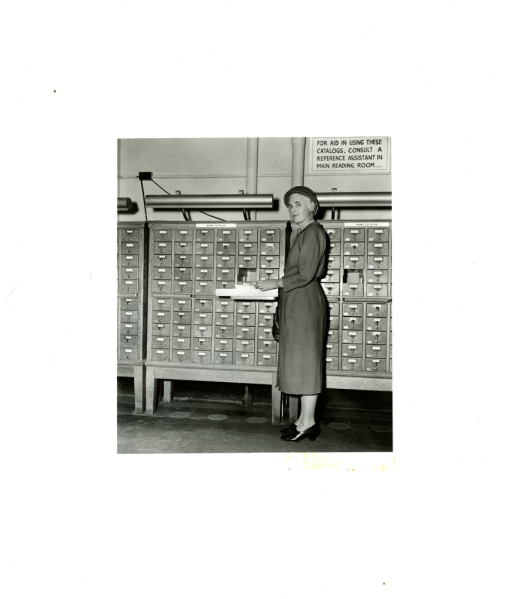 <p>Reference Librarian utilizing a card catalog in the Reference Division of the Army Medical Library.</p>
