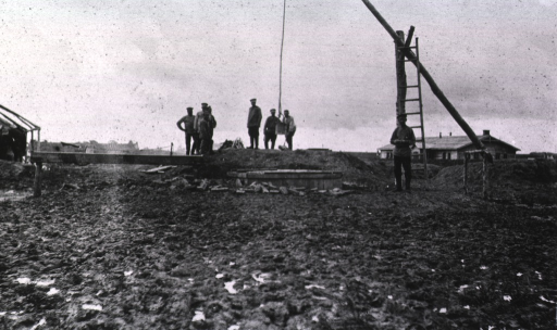<p>Several soldiers(?) stand near the well at Military Hospital No. 45, an isolation hospital.</p>
