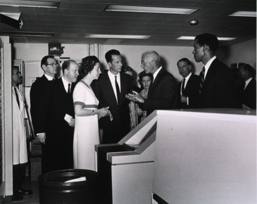<p>Dr. George Williams, Chief of Clinical Pathology Dept., explains the computerizes laboratory equipment to the King and Queen of Belgium.  Also shown are Dr. Robert M. Farrier, Ambassador Mosbacher, John D. Stimpson (CPD staff member), and others.</p>