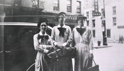 <p>Street scene showing three students in uniform and carrying their bags.</p>