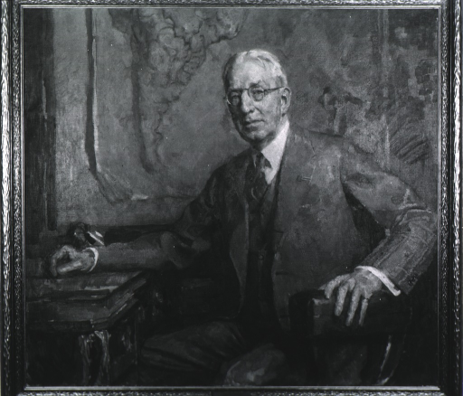 <p>Three-quarter length, full face, seated at desk, one hand on desk, the other on arm of chair.</p>