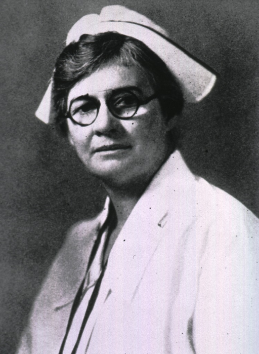 <p>Head and shoulders, left pose, full face, wearing glasses and nurses' uniform.</p>