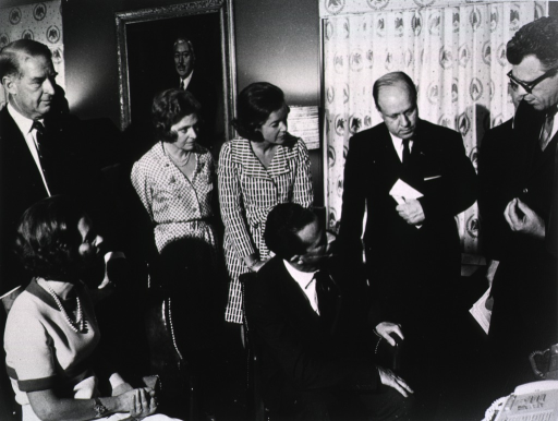 <p>Dr. Arnold Pratt discusses computer technology with the King and Queen of Belgium.  Among those shown are Ambassador and Mrs. Mosbacher.</p>