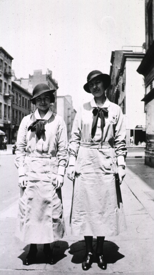 <p>Street scene showing two female students in uniform.</p>