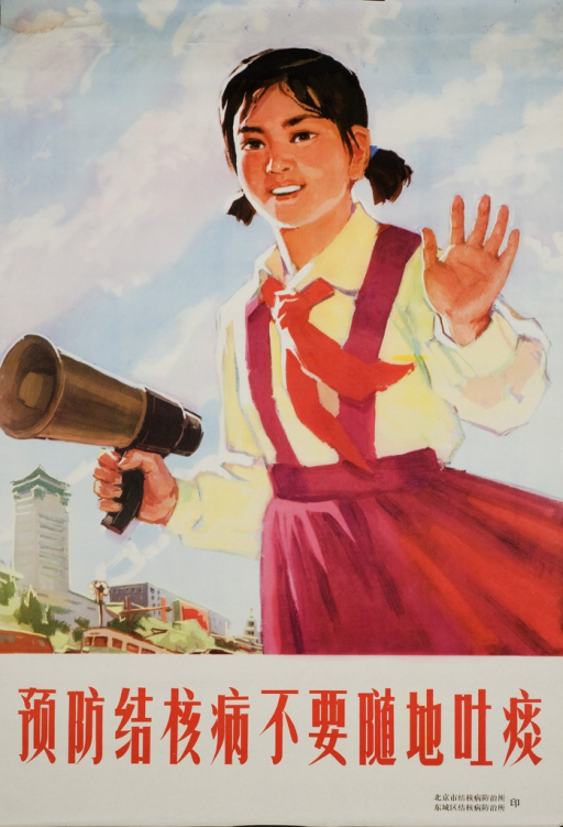 <p>A girl in a red dress with a red necktie holds a loud speaker in one hand and waves with the other.</p>