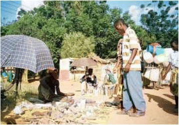 Traditional healers selling medicines in local market.