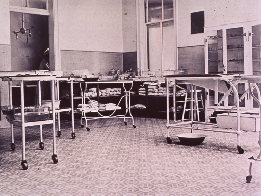 <p>Interior view showing examination tables and shelves of supplies.</p>