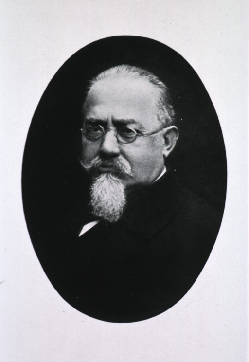 <p>Head and shoulders, left pose, full face; wearing glasses; in oval.</p>