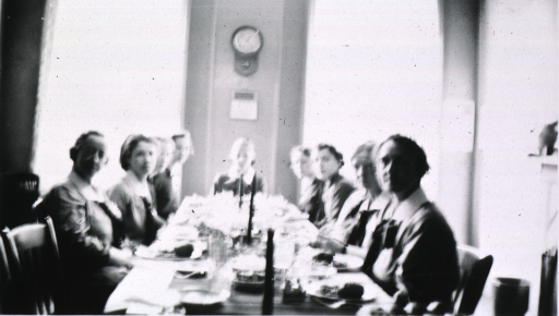<p>Showing the nurses sitting at a long table.</p>