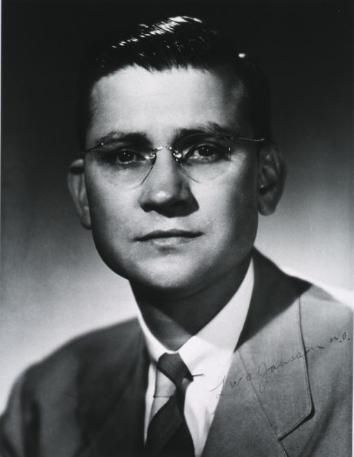 <p>Head and shoulders, front pose, full face; wearing glasses.</p>