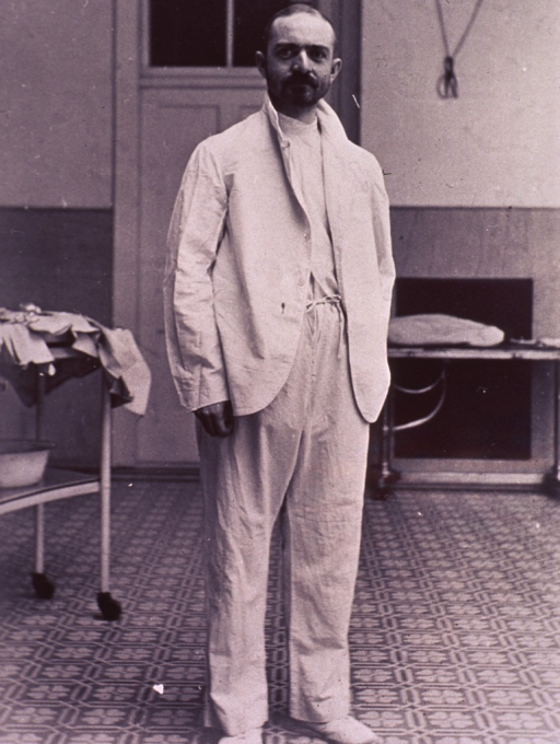 <p>Full length, standing, right pose, full face; wearing white surgical garment.</p>
