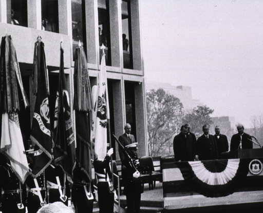 <p>Showing the color guard and Drs. Eberhart, Marston, MacNichol, and Baker with Robert H. Finch and Chaplain Leroy G. Kerney.</p>
