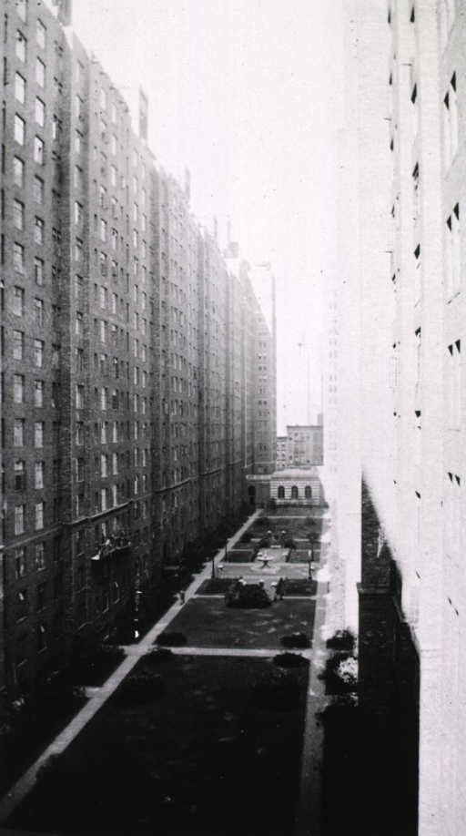 <p>Exterior view showing grounds between two high-rise buildings.</p>