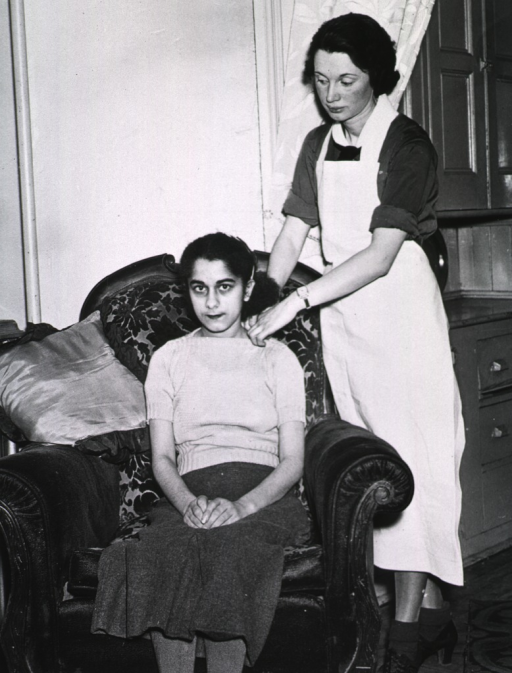 <p>A nurse attends to a sick young girl who is sitting in a chair.</p>