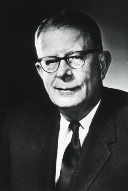 <p>Head and shoulders, full face, wearing glasses and suit.</p>