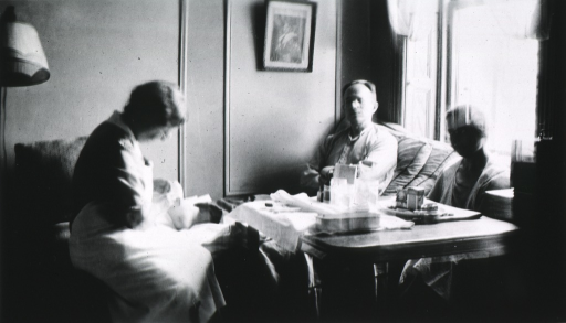 <p>Showing Miss Stafford in a patient's home.</p>