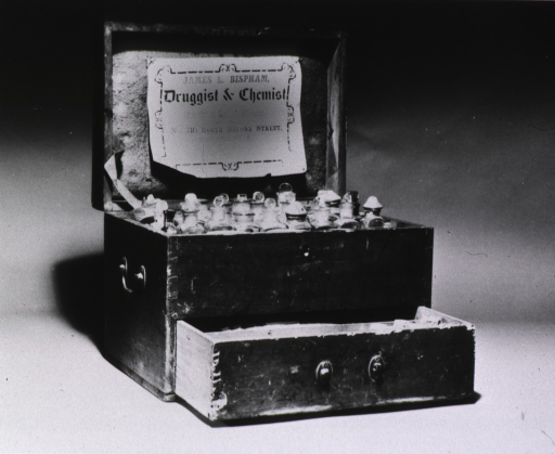 <p>View of the opened medicine chest of James. L. Bispham, with his label affixed to the inside of the top of the chest.</p>