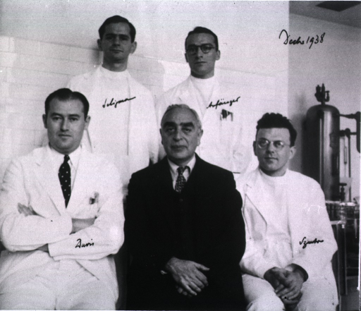 <p>Showing Bela Schick surrounded by his staff for this group portrait.</p>