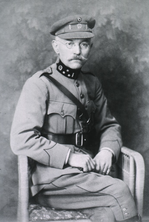 <p>Seated, right pose, in uniform and cap.</p>