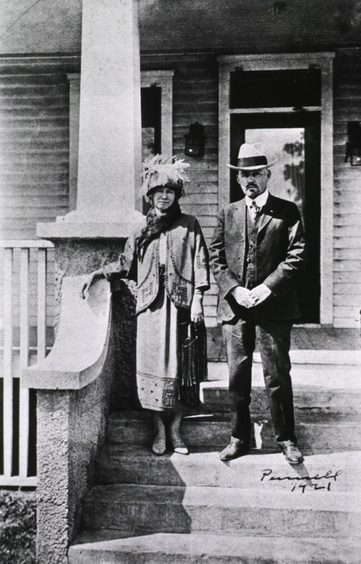 <p>Full length, standing on the steps to the entrance of The Brinkley Hospital.</p>