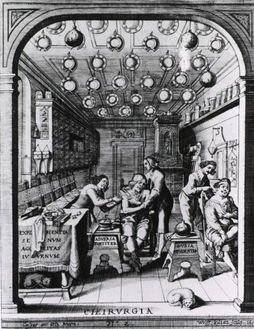 <p>Interior view of a barber-surgeon's establishment: two men are receiving minor surgical treatment; bloodletting basins and jars of leeches are hanging from the ceiling. Two pets (dog and cat?) are resting, one under a table, in the foreground.</p>