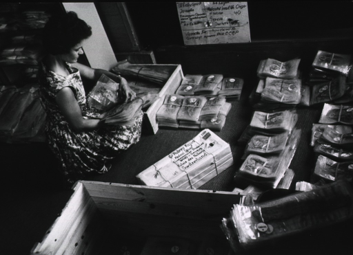 <p>A woman is unpacking a shipment of autopsy specimens.</p>