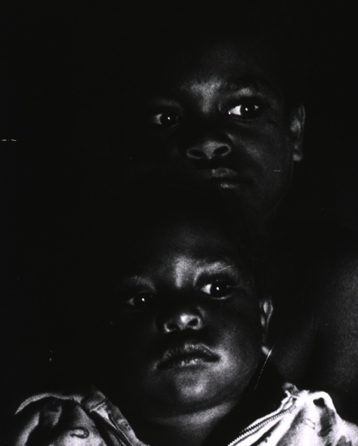 <p>Head and shoulders of two children of the Fore, a primitive tribe living in the Eastern Highlands of New Guinea.</p>