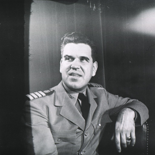 <p>Head and shoulders, seated, right pose, full face; arm over back of chair; wearing uniform.</p>