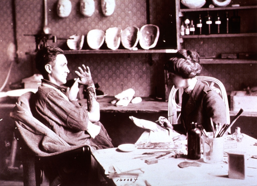 <p>Showing Miss Allen making a wax model of a patient's burned arm.</p>