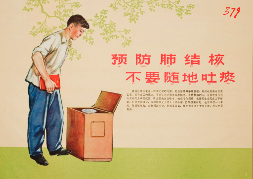 <p>A young man in a white shirt and blue pants holds a red book in his right hand while spitting into a trash can.</p>