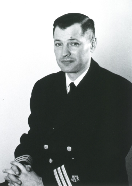 <p>Half length, seated, body to left, full face, hands clasped, wearing USPHS uniform.</p>