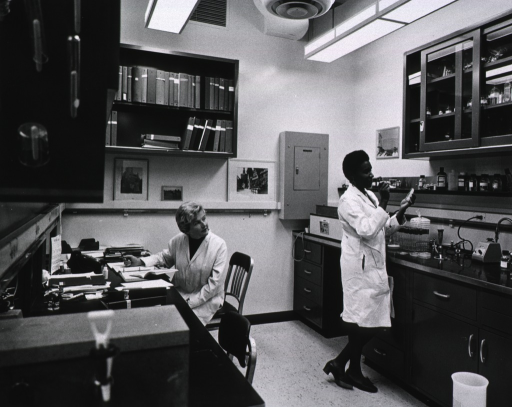 <p>Publicity photographs for the dedication of buildings 36 and 37.  Shown here in a laboratory, typical of those in the new buildings, are Dr. Elisabeth Freese, a biologist, and Blanche Lewis, a laboratory technician.</p>