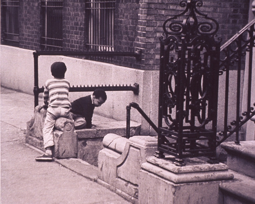 <p>Children playing outside an inner city school or tenement building.</p>