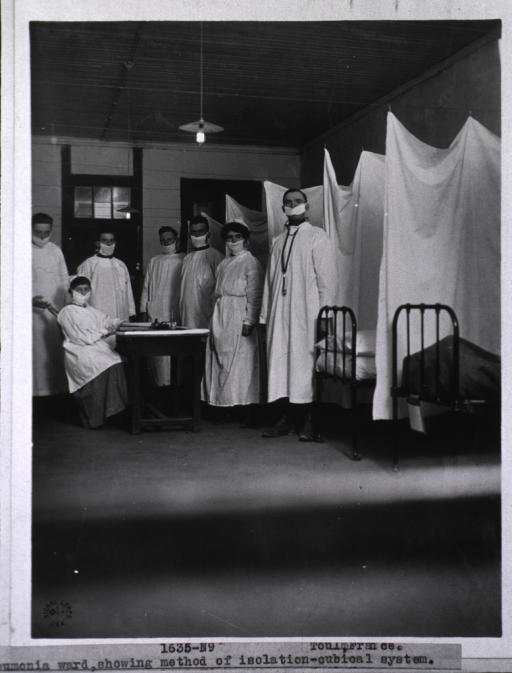 <p>Interior view of pneumonia ward with attendants wearing face masks and showing the method used for isolation of patient cubicals.</p>