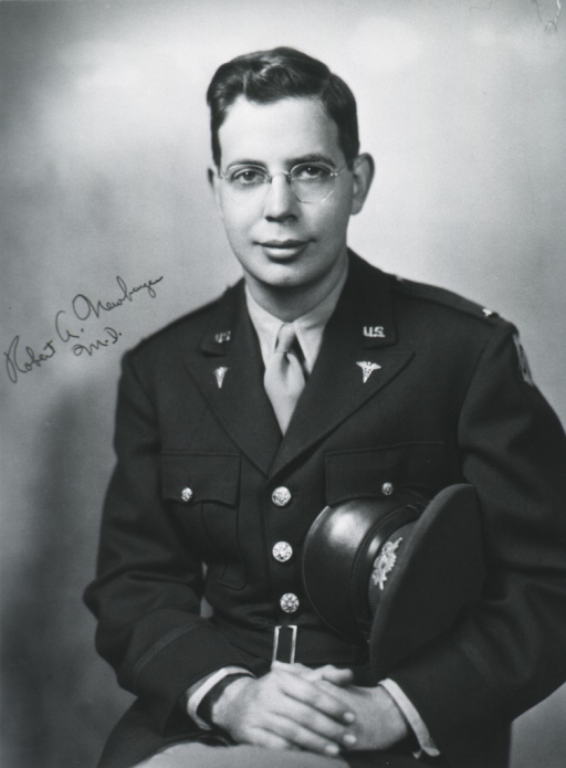 <p>Seated, full face, uniform, holding cap under arm, hands clasped in lap.</p>