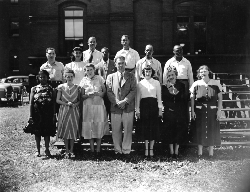 <p>Mr. Cosby Brinkley, head of the Photoduplication Section, Office of the Librarian, stands (front, center) with a team of 13 at the Army Medical Library.</p>