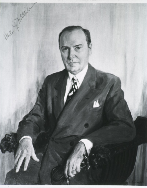 <p>Seated, full face, hands showing.</p>