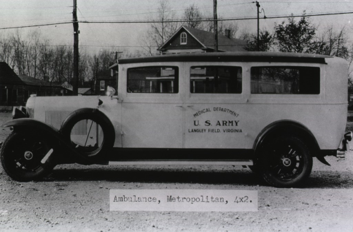 <p>The ambulance is parked on an unpaved lot in front of other buildings.  Printed on the back door of the ambulance is:  &quot;Medical Department U.S. Army, Langley Field, Virginia.&quot;</p>