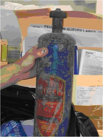 The patient used the old fire extinguisher to unclog his sink, containing methyl bromide.