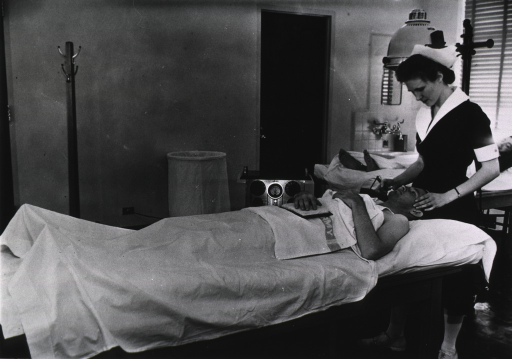 <p>Patient receiving electrotherapy treatment.</p>