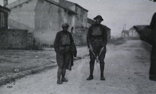 <p>Both:  Full length, standing; wearing uniforms and helmets.</p>